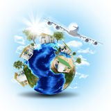Earth with houses and airplane Stock Images