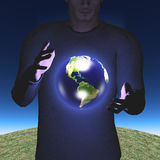 Earth hovers between hands Stock Photography