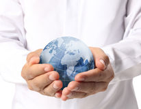 Earth in human hand Royalty Free Stock Images