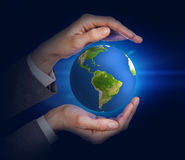 Earth in human hands Royalty Free Stock Image