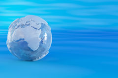 Earth from ice on blue background. Three-dimensional earth from ice on blue background. 3d Royalty Free Stock Image