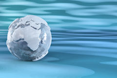 Earth from ice on blue background. Three-dimensional earth from ice on blue background. 3d Stock Image