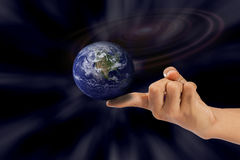 Earth on index finger. Stock Photo