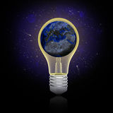 Earth inside the bulb Stock Photo