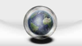 Earth inside glass sphere. In white space Royalty Free Stock Photo