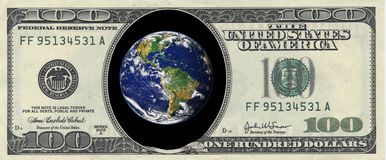 Earth inside a hundred dollar Stock Photos