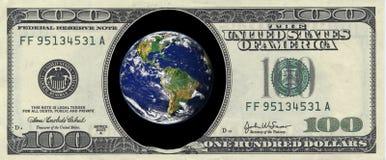 Earth inside a hundred dollar Stock Photos