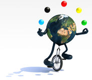 Earth juggle with arms and legs rides a unicycle Royalty Free Stock Photo