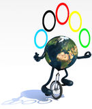 Earth juggle with arms and legs rides a unicycle Royalty Free Stock Photography