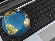 Earth on keyboard Stock Photo