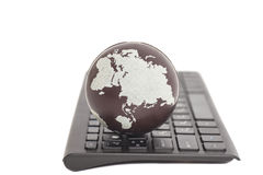 Earth on keyboard Royalty Free Stock Photos
