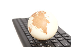 Earth on keyboard Stock Images