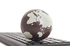 Earth on keyboard Stock Photos