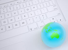 Earth on the keyboard Royalty Free Stock Images