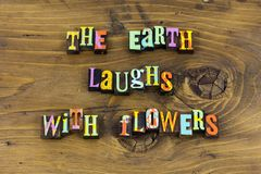 Earth laughing flowers beauty love typography stock photography