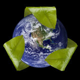 Earth with Leaf Recycle Symbol. Square image of the earth with a recycle symbol made from leaves around it Royalty Free Stock Images