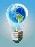 Earth light bulb concept. With blue background, texture from www.Nasa.org Stock Image