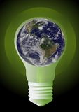 Earth in light bulb Stock Photo