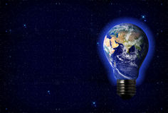 Earth in a lightbulb Royalty Free Stock Photos