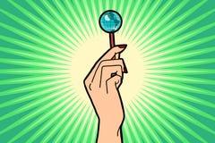 Earth Lollipop in female hand. Comic book cartoon pop art retro color illustration drawing Stock Photos
