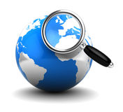 Earth and loupe Stock Photography