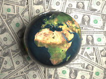 Earth lying on money Stock Photos