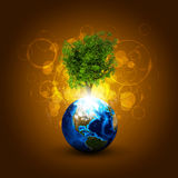 Earth with magical green tree and rays of light Royalty Free Stock Images