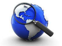 Earth and magnify glass Stock Photography