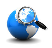 Earth and magnify glass Royalty Free Stock Photo