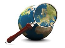 Earth and magnify glass Royalty Free Stock Photography