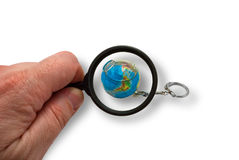Earth is in magnifying glass Stock Photography