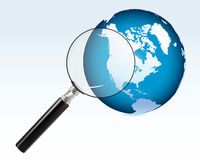 Earth through a magnifying glass Stock Photography