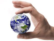 Earth between male fingertips Royalty Free Stock Images