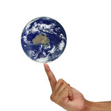 Earth between male fingertips isolated on white background. Elem Royalty Free Stock Photo