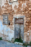 Old collapsing building with a door and a window Stock Photo
