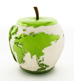 Earth map on half eaten green apple Stock Photos