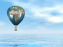 Earth map hot air balloon - 3D render. One hot air balloon with earth map upon water by blue day - 3D render Stock Photography
