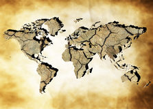 Earth map. Map of the world with continents from dry deserted soil over old paper background royalty free stock image