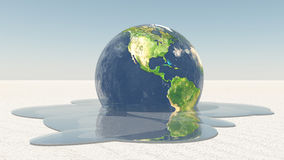 Earth melting into water Royalty Free Stock Photography