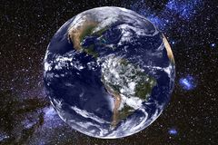 Earth and milky way galaxy. Elements of this image furnished by NASA. Earth and milky way galaxy. Elements of this image furnished by NASA stock photo