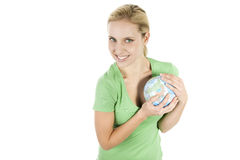 Earth is mine!. Young woman holding earth, in order to protect it Royalty Free Stock Photography
