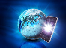 Earth and mobile phone on abstract blue background Stock Image