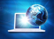 Earth model above laptop Stock Photo