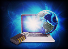Earth model above laptop with lock Royalty Free Stock Images