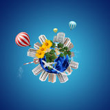 Earth model with city around and flowers Stock Images