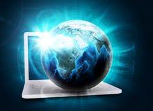 Earth model in haze on laptop Royalty Free Stock Image