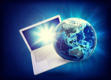 Earth model on laptop at angle Royalty Free Stock Photo