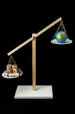 Earth and Money on a Two Pan Balance Stock Image