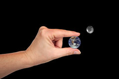 Earth and Moon in Hand Royalty Free Stock Photo