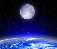 The Earth, Moon, stars. The earth the moon and stars in a free space royalty free stock images